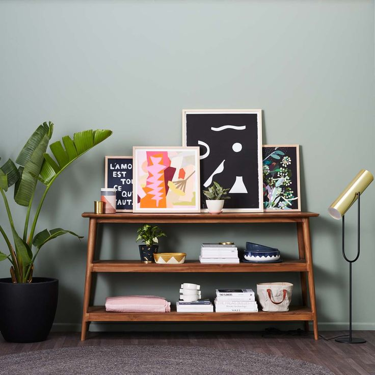 Console goals... some shelfie styling at it's best on this beautiful Vintage 2 Shelf Console by Karpenter. With so many brands we love in one place, tap for details. Everything pictured is available online and in-store now! #consoletable #artwork #prints #brassdetails #concretetableware #concretepot #rug #darktimber #walnut