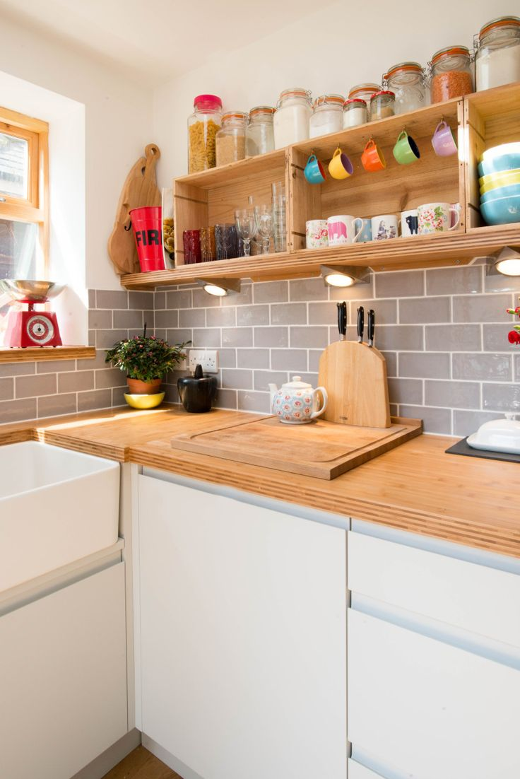 Bright and modern kitchen with reclaimed wine boxes as open shelving, grey tiles and bamboo worktop - Sheffield Sustainable Kitchens