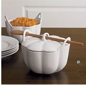 I like the concept, but I feel the handles wouldn't live long, even in porcelain.