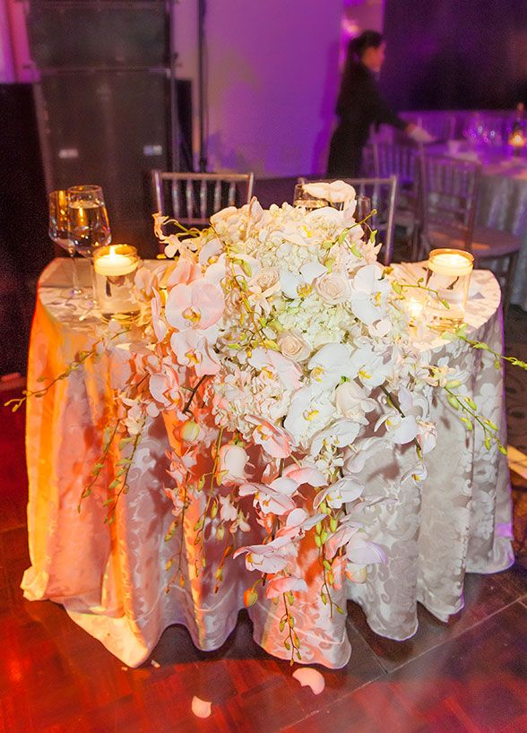 bride grooms table white orchids tabletop