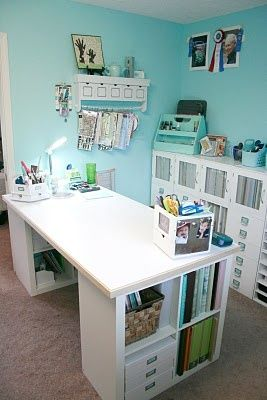 I love this desk. It features two 2x2 Ikea Expedit shelves. - craft room