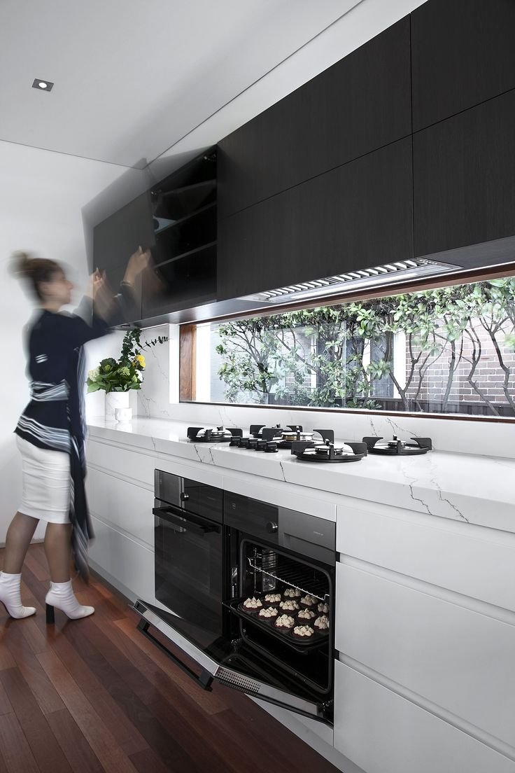 A Designer's Life Bayview Ave Project using Black Wenge Ravine. #LampKitchen