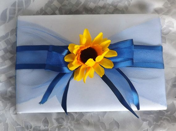 Check out this item in my Etsy shop https://www.etsy.com/listing/468729615/sunflower-with-royal-blue-ribbon-and