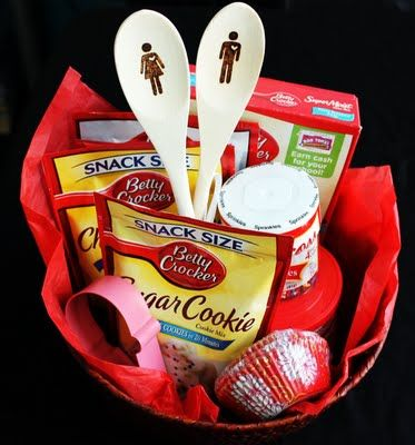 Baking Basket:  Wooden Spoons   Basket  Fun flower cupcake liners  All baking supplies are from Betty Crocker  Red bag   Ribbon  Tag