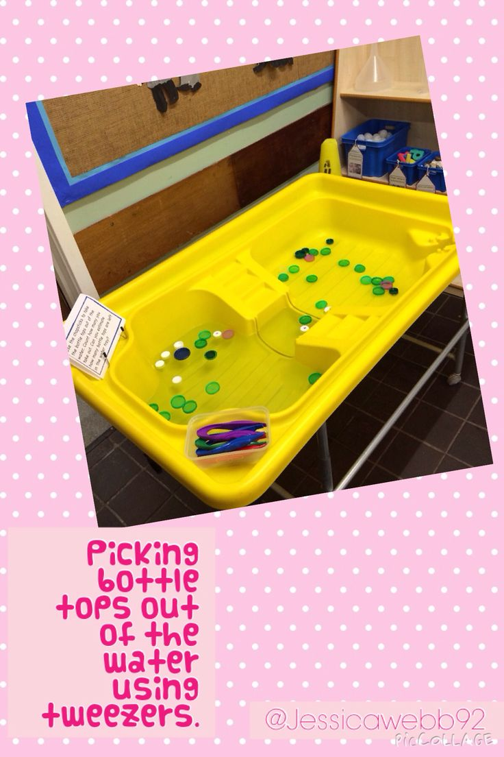 Picking out floating bottle tops using tweezers. EYFS