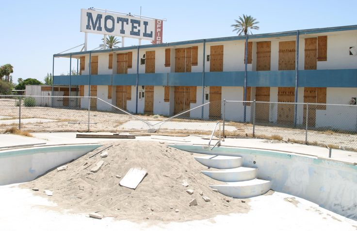 Salton Riviera, California.  People stopped coming to the salton sea. Vacation homes were abandoned, resort developments stopped in mid construction. Neighborhoods to be, never were. RVs, boats, spas and yacht clubs, were all left behind. Today where thousands once lived and played, only a few hundred remain in each of the tiny shoreside communities, surrounded by the ruins of vacation homes. Decades after being abandoned, the effects of water, sun and salt, are clear.