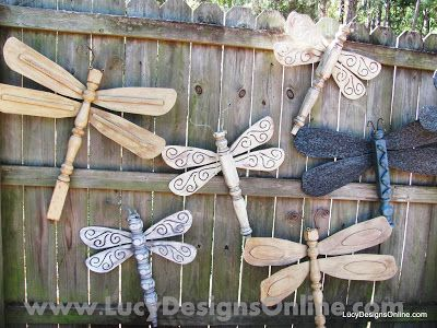 Dragonflies made with Ceiling Fan Blade Wings and table leg Bodies by Lucy Designs. What a cool idea for a broken fan and they are big enough to really make a statement on a garden fence or wall.