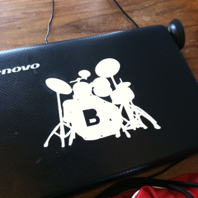 Drum kit dye cut sticker on laptop.
