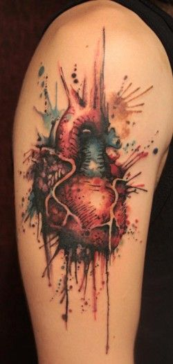 A human heart becomes a master art work in this watercolor painting by Gene Coffey. The artist has used high contrast and organic splashes of paint to add visual appeal to this tattoo. [source]