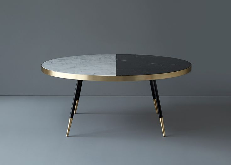 British designer Bethan Gray has created a collection of tables with marble tops wrapped in bands of brass.