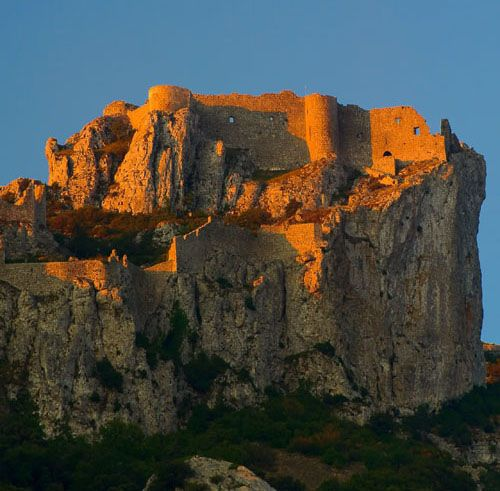 Castèl de Pèirapertusa (Château de Peyrepertuse),  Duilhac-sous-Peyrepertuse, Aude, France...     www.catharcountry.info   ...     Peyrepertuse is a ruined fortress and one of the Cathar castles of the Languedoc located in the French Pyrénées. It was associated with the Counts of Barcelona, later kings of Aragon before the area was annexed by France. The name Peyrepertuse is derived from Pèirapertusa, Occitan, meaning Pierced Rock.