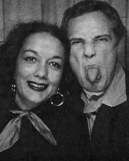 Marlon Brando Showing us what he thinks of Hollywood In 1960 with his then soon-to-be second wife, Mexican-American actress Movita Castaneda.