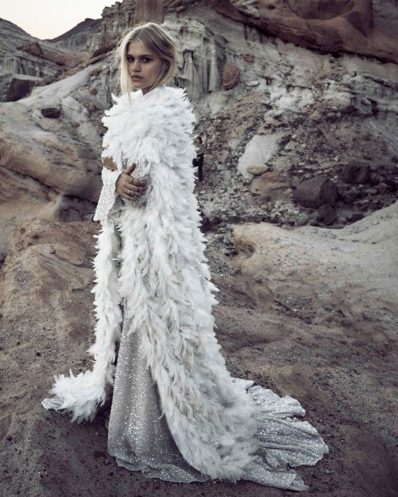 For winter brides • From the Empress Collection (launching early this year) this luminous, quicksilver gown by Odylyne The Ceremony is what celestial dreams are spun from. Pair this floor length feathered cape for serious drama.Silver Gown & Feathered Cape, Odylyne The Ceremony