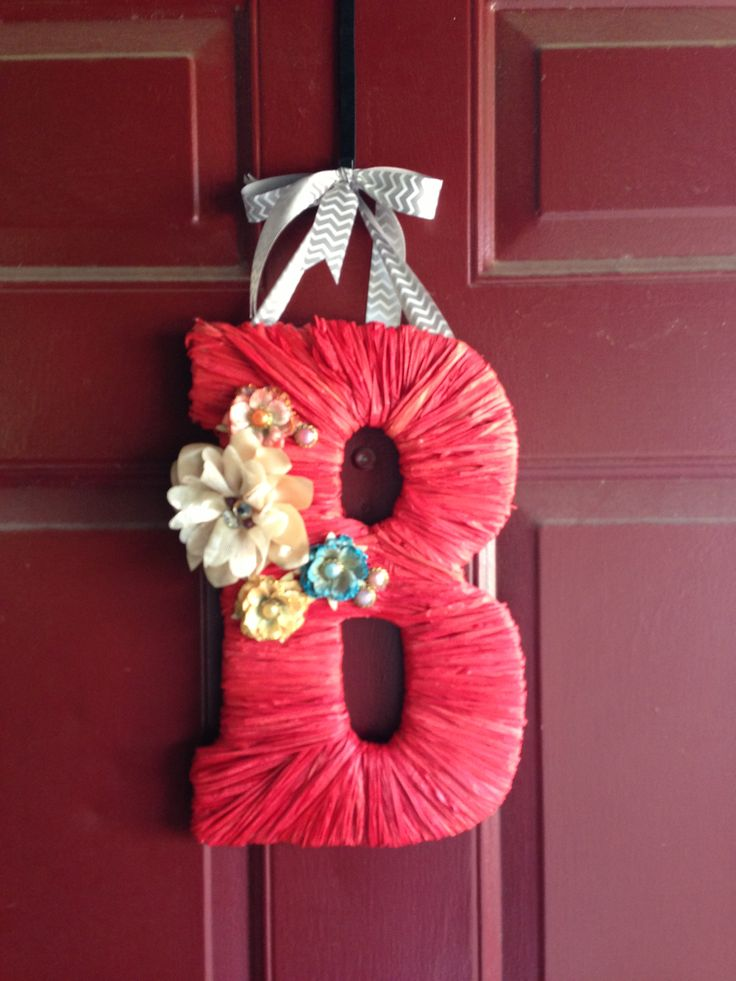 My DIY initial door hanger with chipboard letter from Hobby Lobby and raffia :)
