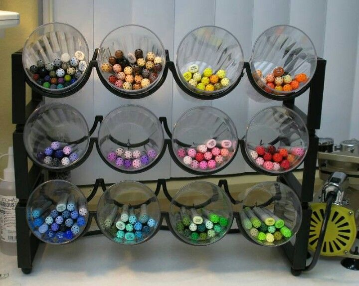 Wine rack with cups to hold markets, colored pencils for craft desk