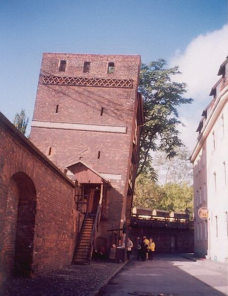 The Leaning Tower is undoubtedly the most attractive and famous tower in Toruń. This tower was a typical fortified tower, built as a part of the city walls at the turn of the 14th century clearly as a straight tower. Initially, despite its four-wall foundation, it did not have the front wall, which facilitated hoisting ammunition onto the higher floors. This popular tourist attraction leant as early as the Middle Ages presumably due to the instability of the ground and has been stable ever…