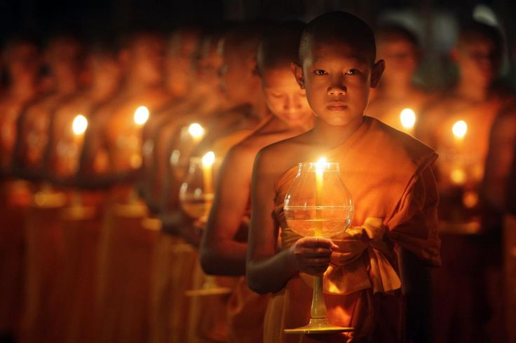 Young #Buddhist monks hold candles during the festival of Yee Peng in the northern capital of Chiang Mai, #Thailand on October 25, 2014. (DARIO PIGNATELLI)
