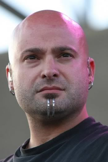 David Draiman is best known as the frontman of the nu metal/hard rock band Disturbed. Description from metal-archives.com. I searched for this on bing.com/images