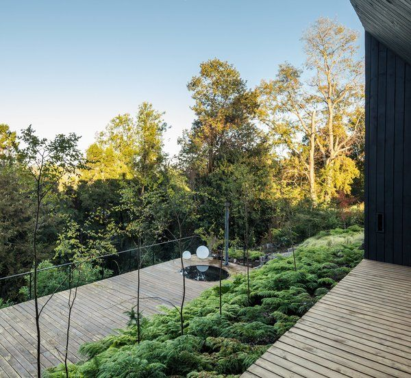 How to Create a Modern Outdoor Oasis to Enjoy Year-Round - Photo 2 of 8 - The lower terrace, which features a hot tub, is farther down the hill to immerse its users in the landscape.