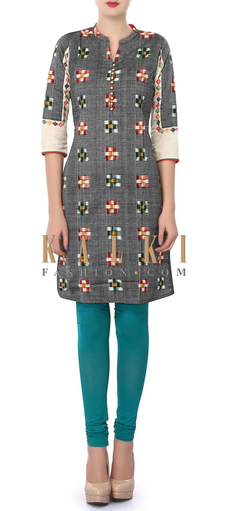 Buy Online from the link below. We ship worldwide (Free Shipping over US$100). Product SKU - 320707. Product Price - $39.00. Product Link - http://www.kalkifashion.com/grey-kurti-enhanced-in-checks-motif-only-on-kalki.html