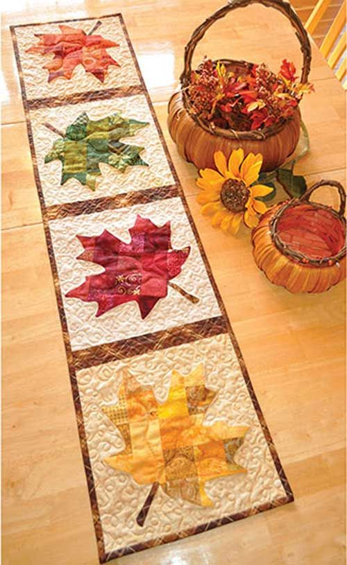 Say hello to the winds of autumn! This stunning table runner features a patchwork design that gives each lovely leaf a textured look normally only found in