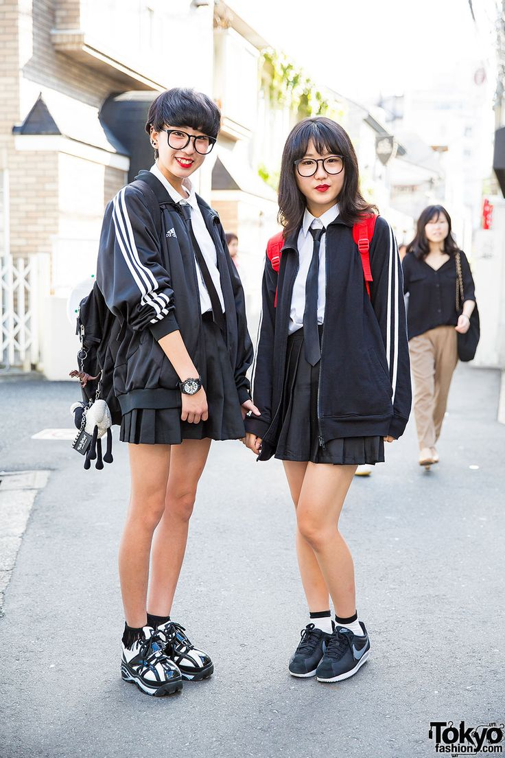 Haruka (17) and Otoha (16) on the street in Harajuku wearing their school uniforms with glasses, backpacks, along with Nike and Adidas resale items.