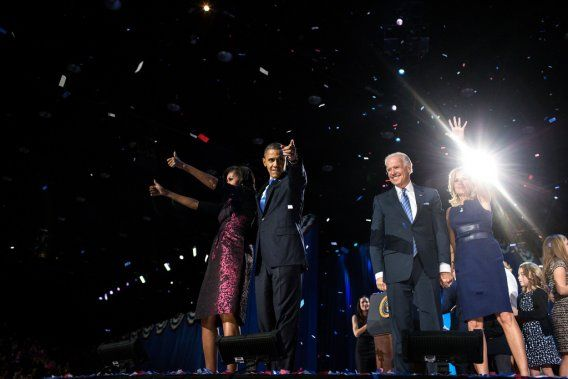 Obama walks on stage to deliver his re-election victory speech with First Lady Michelle Obama, Vice President Joe Biden and his wife, Jill Biden.