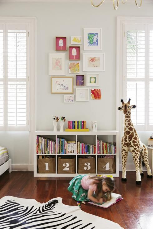 Great playroom storage idea | gallery wall art for kids art Designer & Vintage Dealer, Lauren Lail's home - Charleston Magazine, March 2014