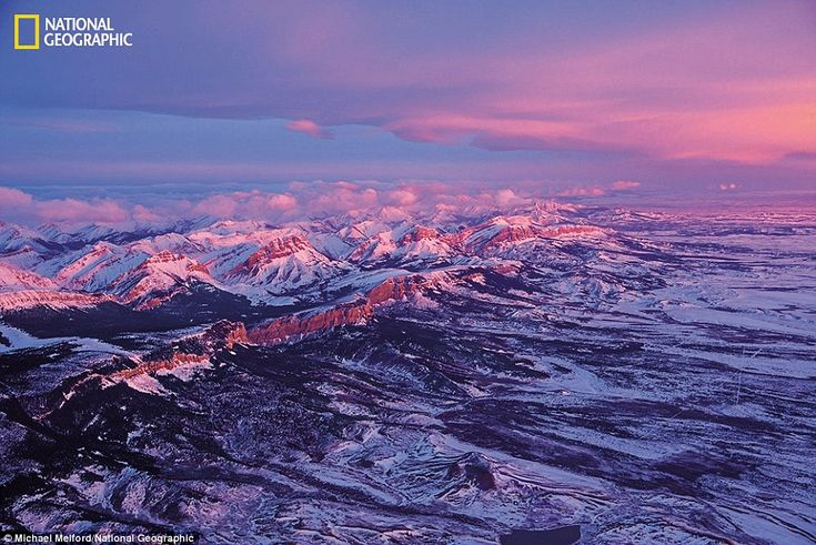 Icy calm: Day breaks on the Front Range in Montana. The mountains and plains in this region shelter a rich collection of plants and wildlife, including grizzly bears