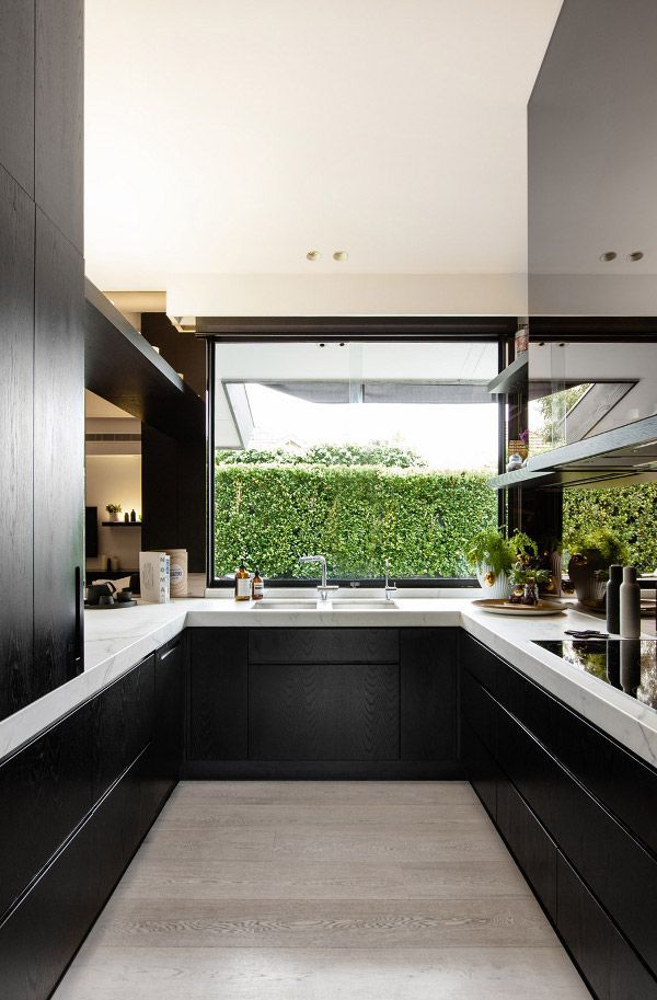 Black and white kitchen by Studio You Me.