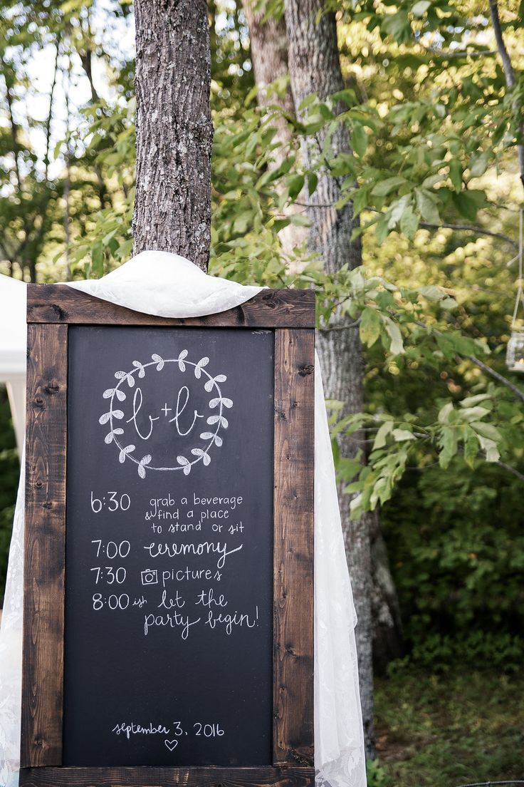 Hand built chalkboard sign for lakeside wedding itinerary