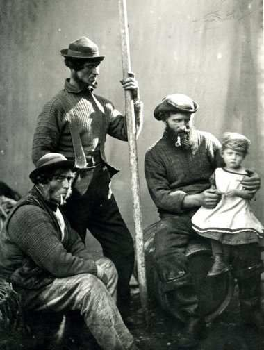 Charles Jolliff (1808-1887) next to his eldest son, Charles (jnr) and to the right, Polperro fisherman, Jim Curtis holding his daughter Kate - born in 1874.