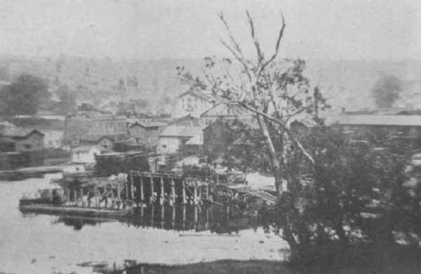 http://www.familyoldphotos.com/photo/pennsylvania/18898/canal-basin-and-canal-sharon-pa  The Canal Basin and Canal... taken from Jenny Burg Hill, Sharon.  Probably taken from the site of the old Turner Lime Kiln.  The rear of the canal boat is seen to the left of the loading incline.  The Wallis and Carley lumber yard can be seen in the background.   Photo from Sharon's Yesterdays and Tomorrow, 1935.