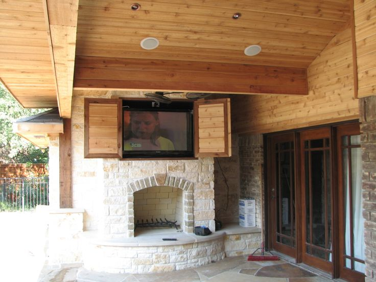 Marvelous Stacked Stone Rustic Fireplace Under Built In Outdoor Tv Cabinet With Wooden Ceiling