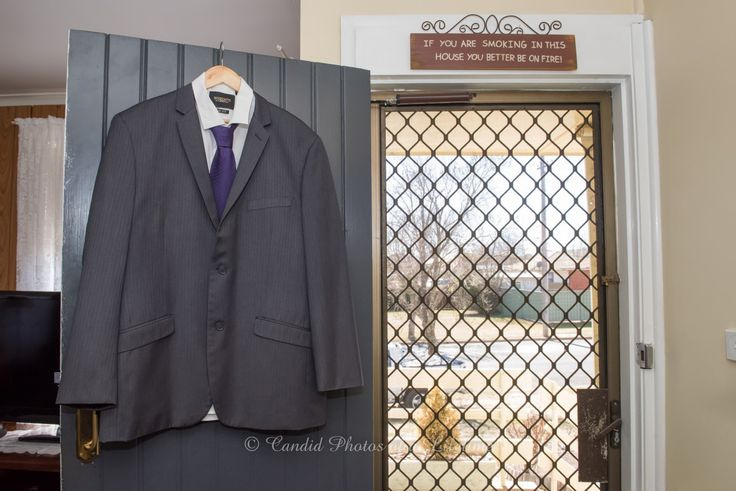 Wedding photographer, Candid Photos of a Lifetime - the grooms suit