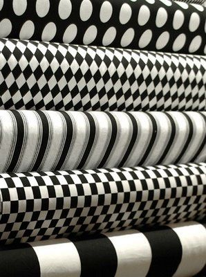 love bold black & white patterns - a favorite chair or large ottoman/coffee table, as frames for vintage cartoon drawings, or as a wacky set of curtains in an otherwise sedate room!