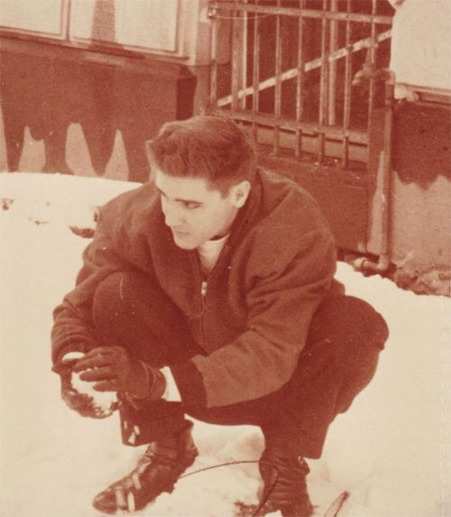 Elvis playing in the snow, in Friedberg, Germany, c. 1958.