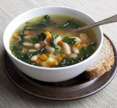 Collard Greens & White Bean Soup - I've added shredded chicken and stelline star pasta to help stretch this meal.