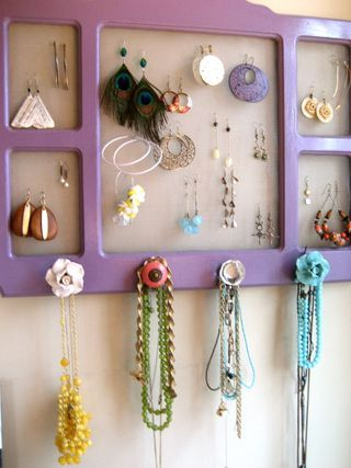 Paint a collage frame, remove the glass, back with screen, and add knobs! Adorable!