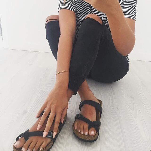 striped tshirt, black skinny jeans with knee rips, black birkenstock sandals
