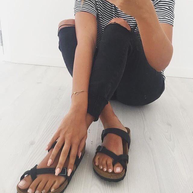 striped tshirt, black skinny jeans with knee rips, black birkenstock sandals