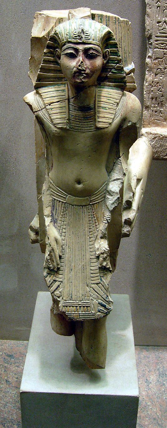 Figure of Ramesses II from a votive statue-  Dynasty  19-limestone and paint.  Metropolitan Museum