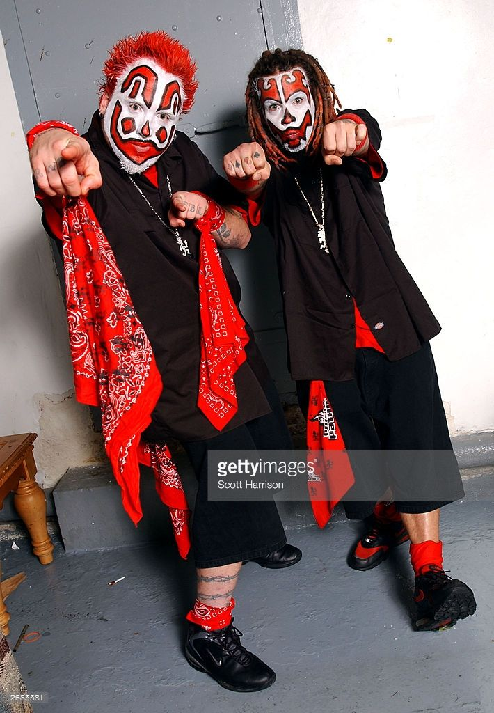 Rappers Shaggy 2 Dope (r) and Violent J (l) of the Insane Clown Posse pose backstage October 30, 2003 at the Riviera in Chicago, Illinois.