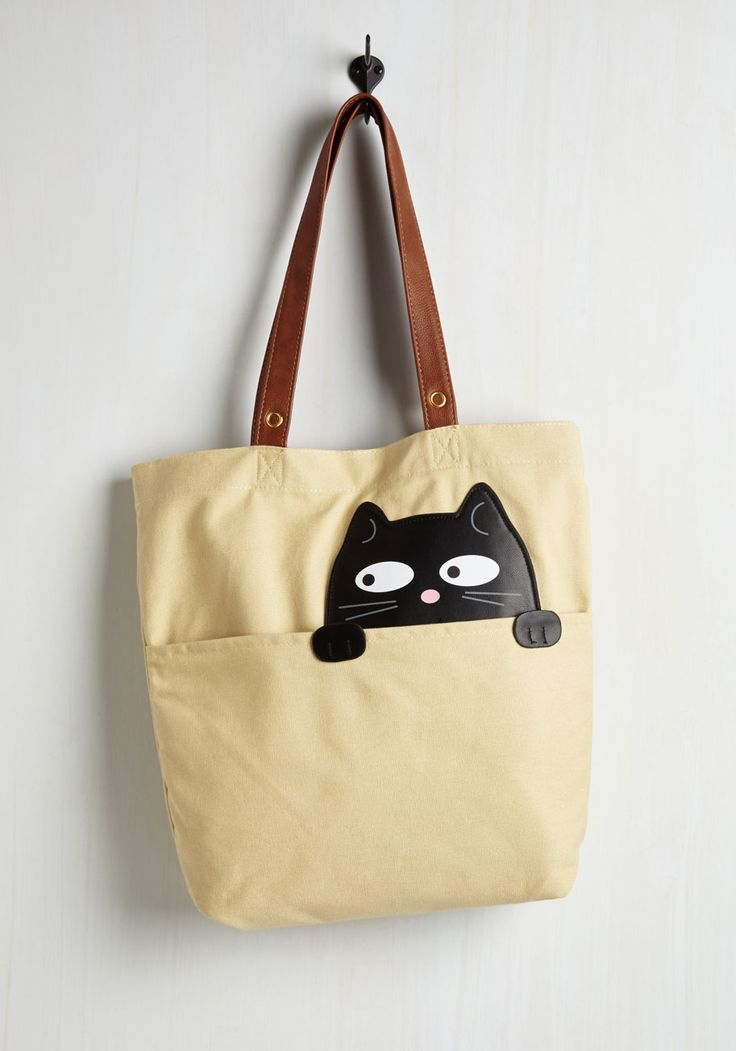 Got One Friend in My Pocket Tote in Black Cat. Keep your favorite critter pal nearby with this canvas tote bag. #cream #modcloth: