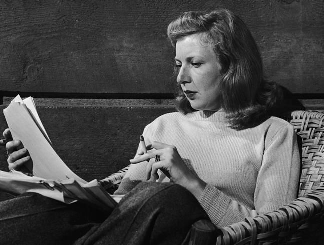 Martha Gellhorn reads. This pic is from Travels with Myself and Another, describing a sea voyage to China with her husband, Ernest Hemingway