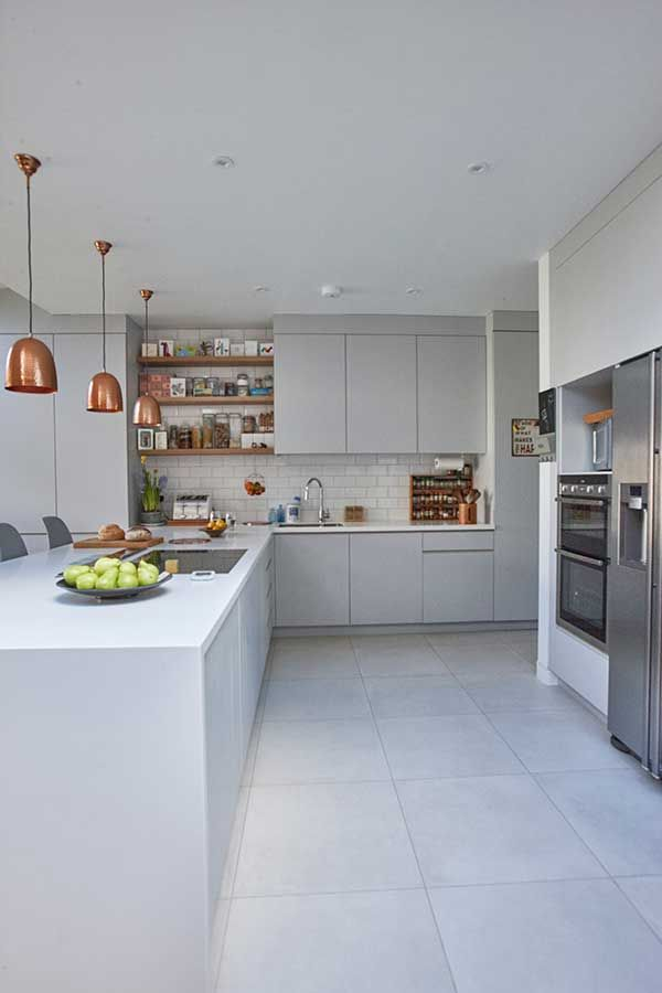 Grey units, white tiles & wood accents.
