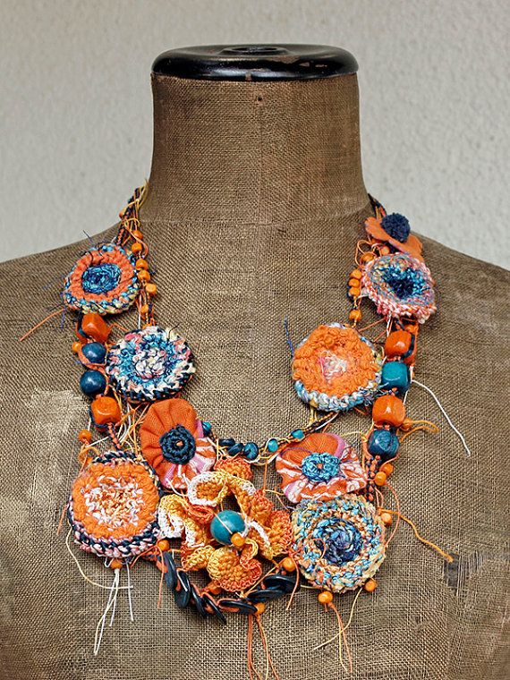 crochet, beads, fabric all manipulated into circles appended as necklace