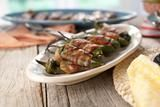 Grilled Stuffed Jalapeno Chiles Recipe video - http://www.foodnetwork.com/videos/grilled-bacon-cheese-jalapenos/101541.html