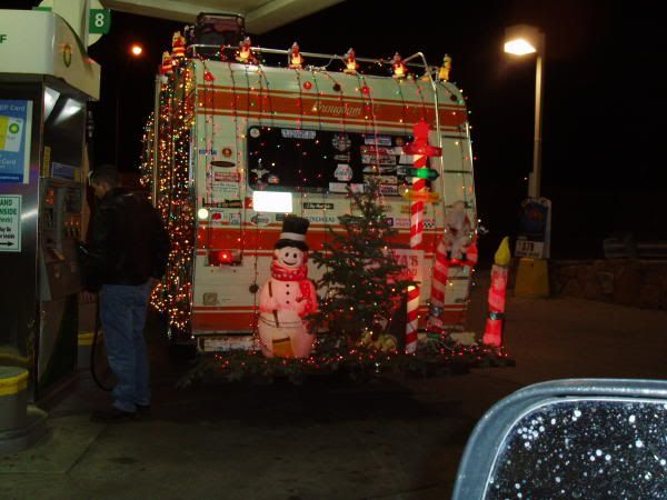 Moving rv decked out in christmas lights and decorations for Airstream christmas decoration