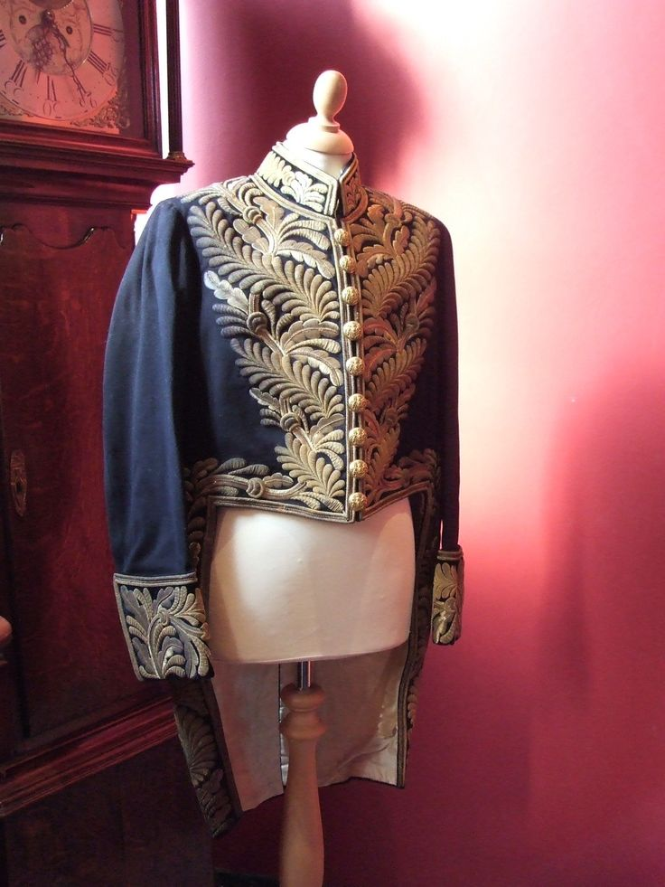Jacket worn by industrialist, politician and art collector J.F.Cheetham to the coronation of King George V in 1911. The buttons bear the Stalybridge Coat of Arms.